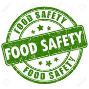 green and white food safety sign