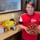 boy in kitchen holding plate of energy balls